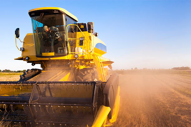 Combine Harvester Combine Harvester agricultural machinery stock pictures, royalty-free photos & images