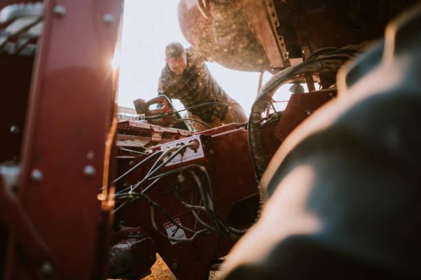 Combine Harvester Working Idaho Wheat Field stock photo