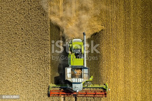 istock Combine working on the wheat field 626530860