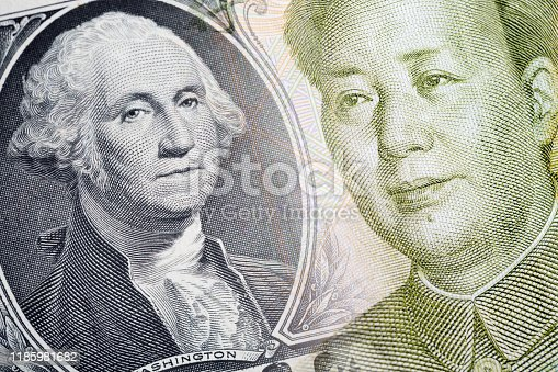 Combined image of The 1 Yuan chinese currency and the 1 american dollar banknotes. Finance concept