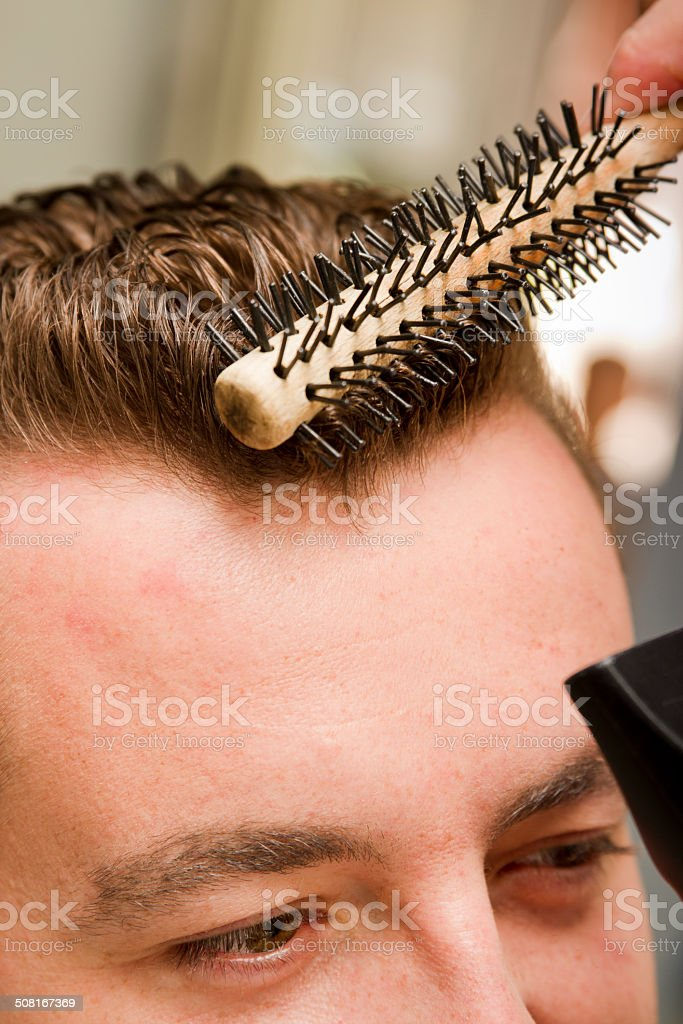 Combing Hair Customer At Coiffeur stock photo