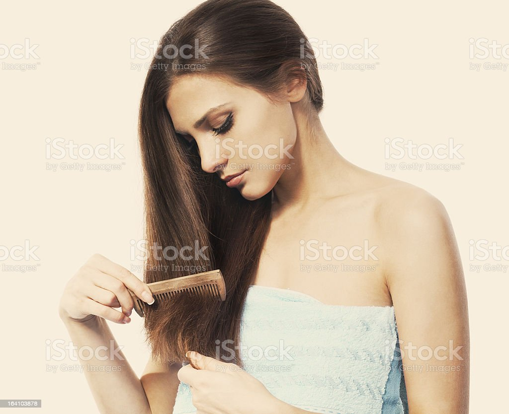 Combing  hair stock photo