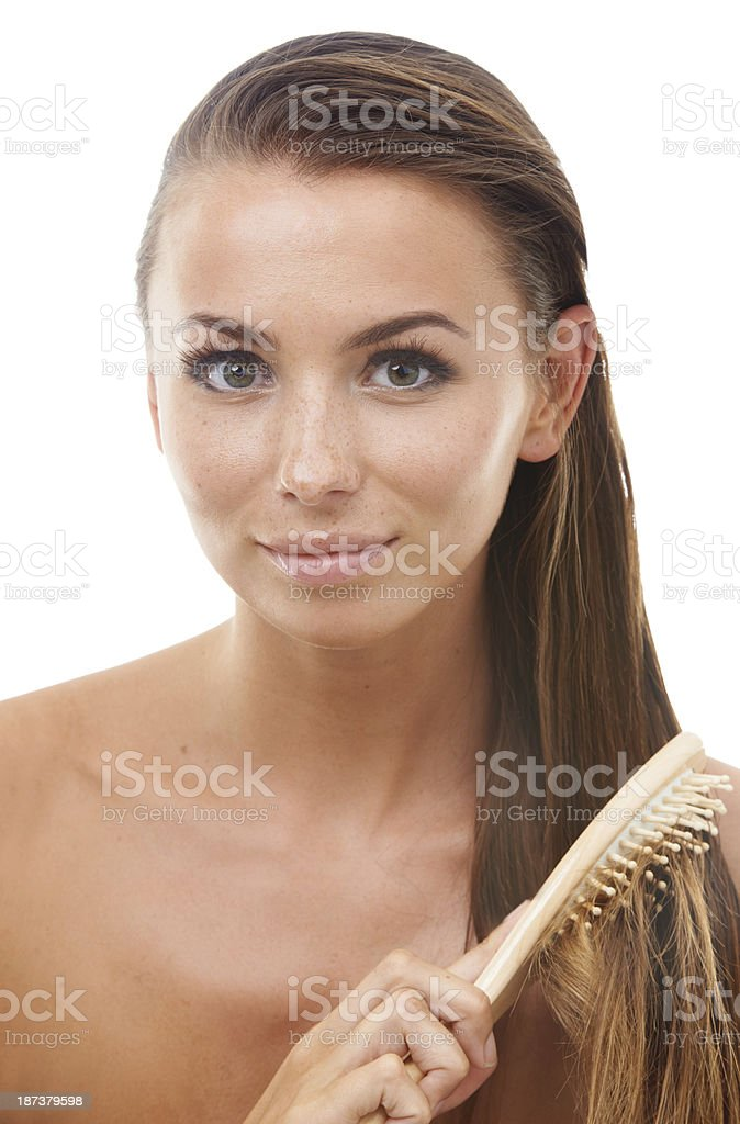 Combing out her hair after a treatment royalty-free stock photo