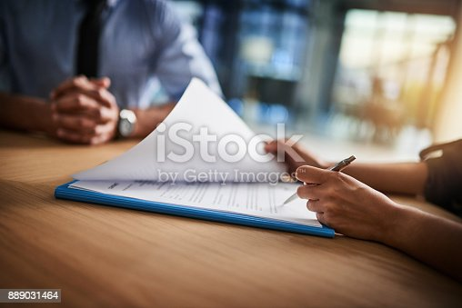 istock Combing through the fine print 889031464