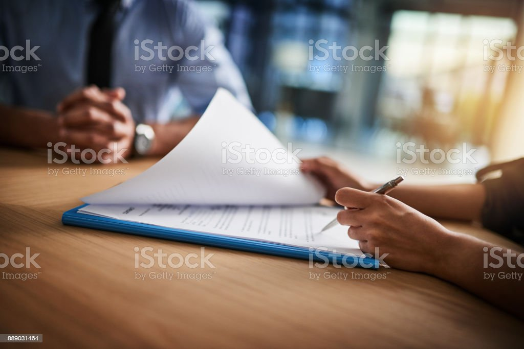 Combing through the fine print stock photo