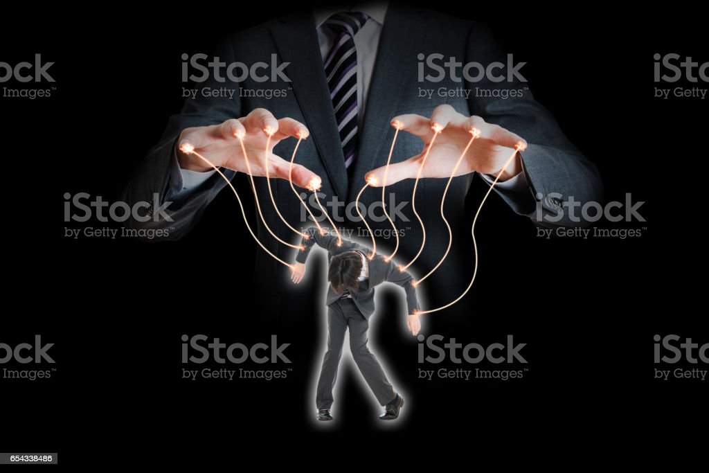 Combining puppetry and a Japanese businessman stock photo