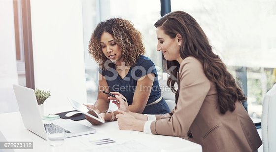 istock Combining their corporate talent 672973112