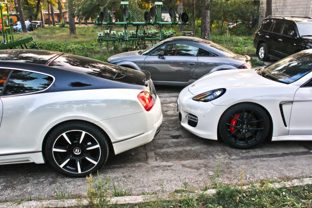 Combo Supercars. Mansory Bentley Continental GT & Porsche Panamera Turbo S 4.8 in the city stock photo