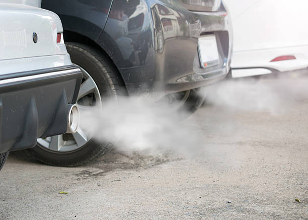 combustion fumes coming out of car exhaust pipe - co2 bildbanksfoton och bilder
