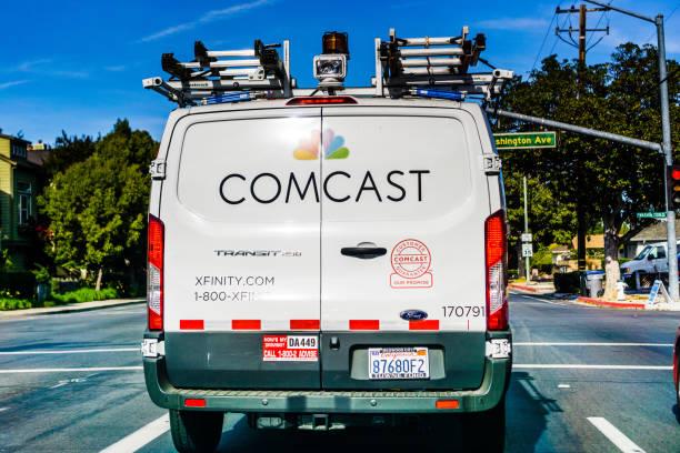 Comcast cable xfinity service van driving on the street picture id1064271670?b=1&k=6&m=1064271670&s=612x612&w=0&h=hzl9xfhc7h3kamxzy9n3eugvb7jy3xw6jkrtkoxmprm=