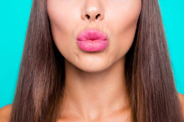 Come closer I'll kiss you! Close up photo portrait of cute sensitive attractive pretty gorgeous big natural woman's lips isolated on bright vivid pastel background stock photo