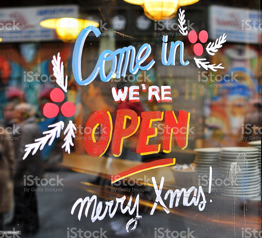 Come in sign in the street shop stock photo