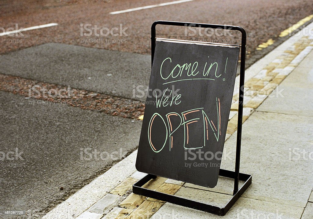 Come in we are open stock photo