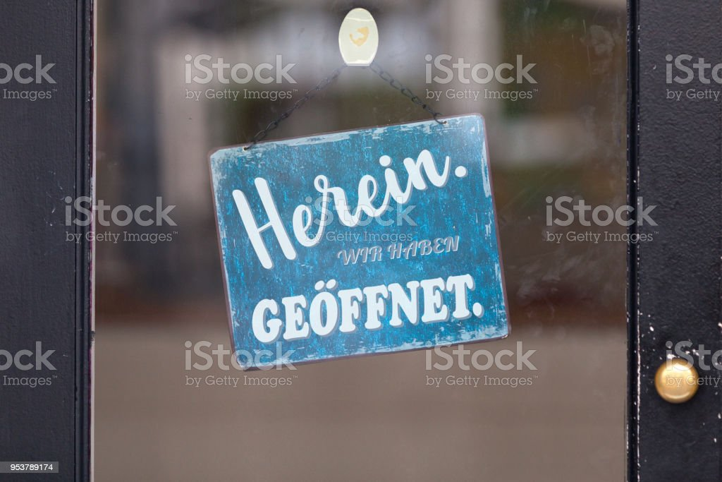 Come in, we're open - German sign stock photo