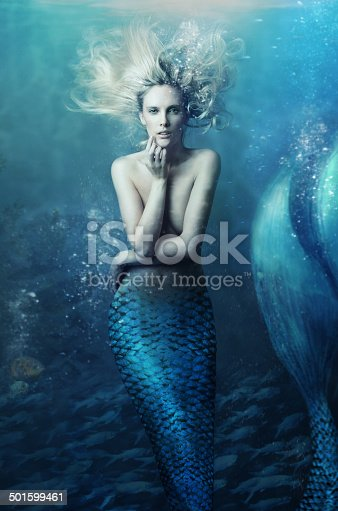 Shot of a mermaid swimming in solitude in the deep blue sea - ALL design on this image is created from scratch by Yuri Arcurs' team of professionals for this particular photo shoothttp://195.154.178.81/DATA/i_collage/pi/shoots/783469.jpg