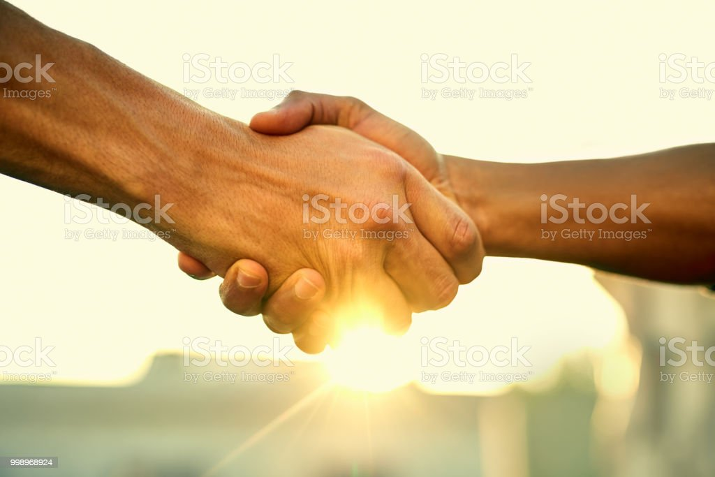 Come together, do great things Cropped shot of two people shaking hands outdoors Achievement Stock Photo