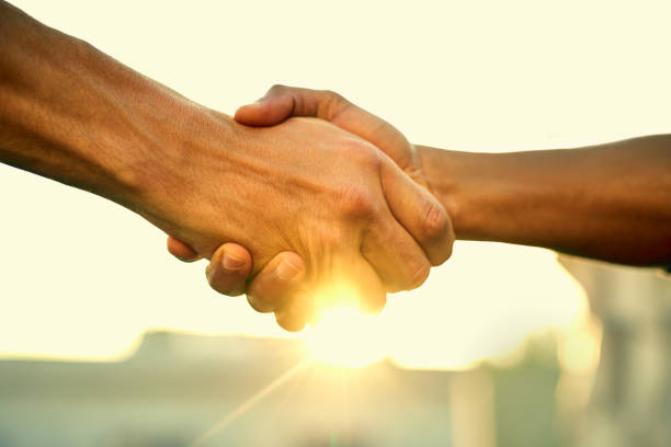Come together, do great things Cropped shot of two people shaking hands outdoors alliance stock pictures, royalty-free photos & images