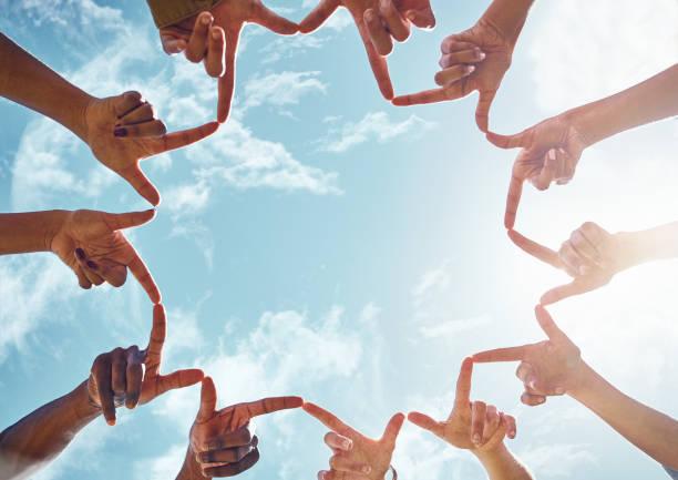 come together in peace - mano donna dita unite foto e immagini stock