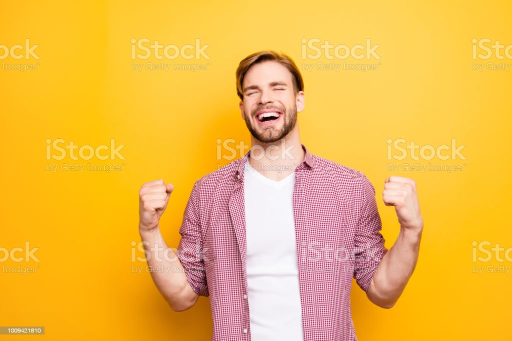 Come true want wish desire best leader leadership people person concept. Portrait of excited cheerful rejoicing delightful ambitious proud  guy raising fists up isolated on bright background copyspace stock photo