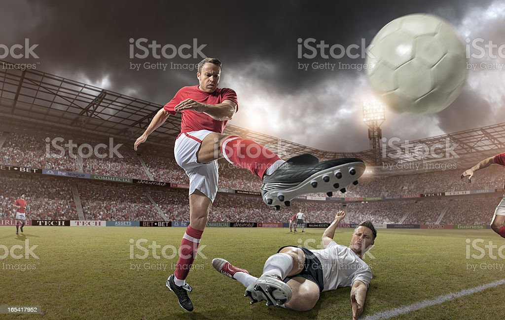Come Up Soccer Player Kicking Football stock photo
