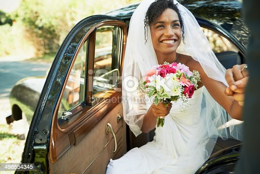 Shot of a bride being helped out of the backseat of a carhttp://195.154.178.81/DATA/i_collage/pu/shoots/784347.jpg