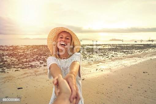 istock Come with me- follow me concept, girl leading boyfriend to beach 692055994