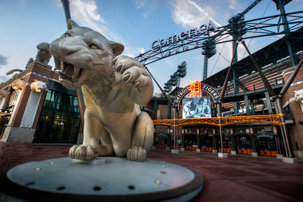 Comerica Park in Detroit, Michigan Detroit, Michigan, USA - July 30, 2017:  Comerica Park is an open-air ballpark located in Downtown Detroit. It serves as the home of the Detroit Tigers of Major League Baseball, replacing Tiger Stadium in 2000.  The park is named after Comerica Bank, which was founded in Detroit and was based there when the park opened. While Comerica has since moved its headquarters to Dallas, the bank still retains a large presence in the Detroit area. The stadium's seating capacity is 41,299. Downtown public transportation for the park is available via the Detroit People Mover station at Grand Circus Park, and the QLine at the Montcalm Street station. Comerica Park sits on the original site of the Detroit College of Law. major league baseball stock pictures, royalty-free photos & images