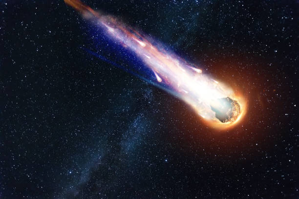a comet, an asteroid, a meteorite falls to the ground against a starry sky. attack of the meteorite. meteor rain. kameta tail. end of the world. astranomy. - shooting stars stock photos and pictures