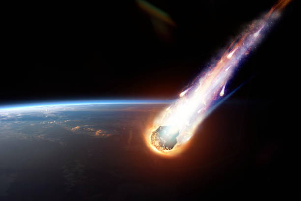 A comet, an asteroid, a meteorite glows, enters the earth's atmosphere. Attack of the meteorite. Meteor Rain. Kameta tail. End of the world. Elements of this image furnished by NASA. Mixed media. stock photo