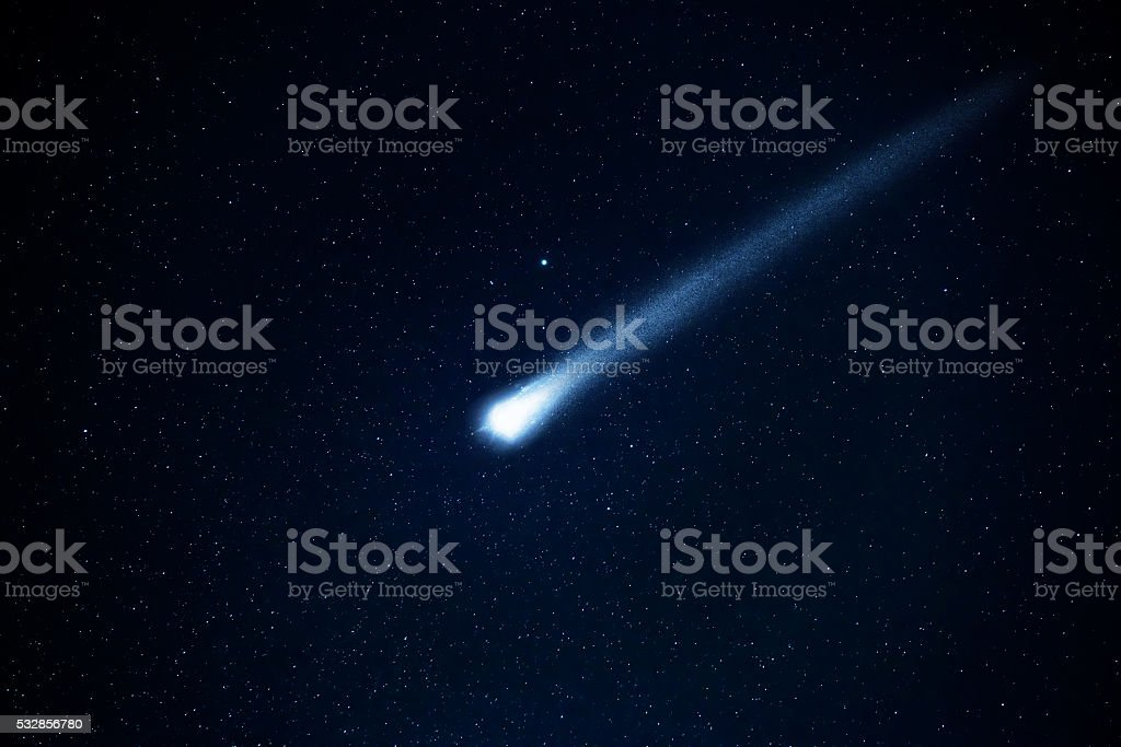 Comet in the starry sky. stock photo