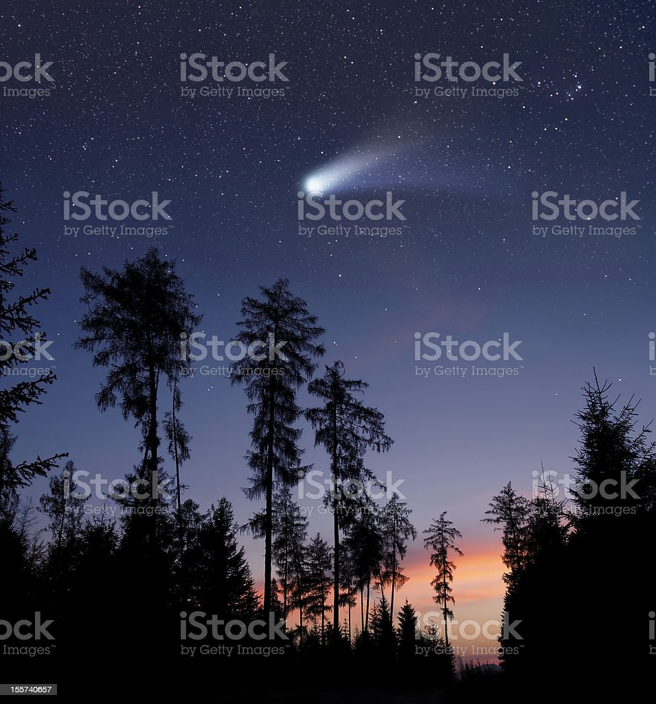 Comet moving in the evening sky stock photo