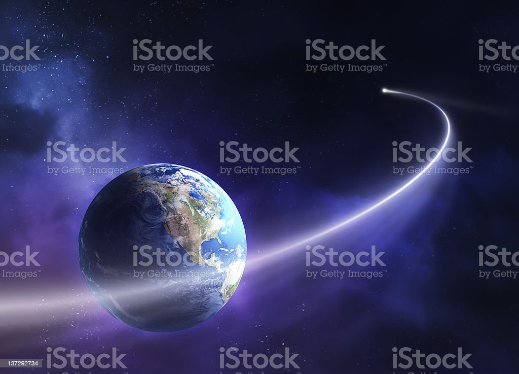 Comet moving past planet earth stock photo