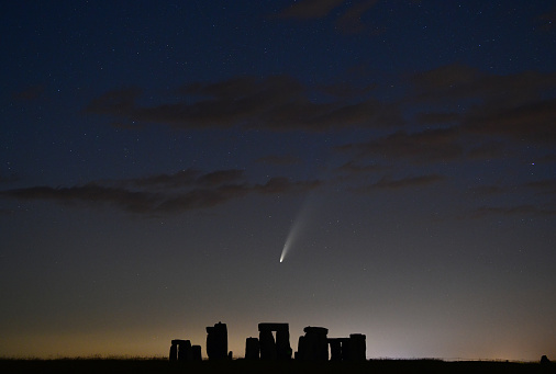 Comet Neowise streaks over the ancient stone circle and lone silhouette figure in Wiltshire, UK\nA very rare astronomical event  - a spectacular sight streaking across the skies over the UK and around the world.\n\nComet Neowise - officially called C/2020 F3 – first appeared towards the end of March.