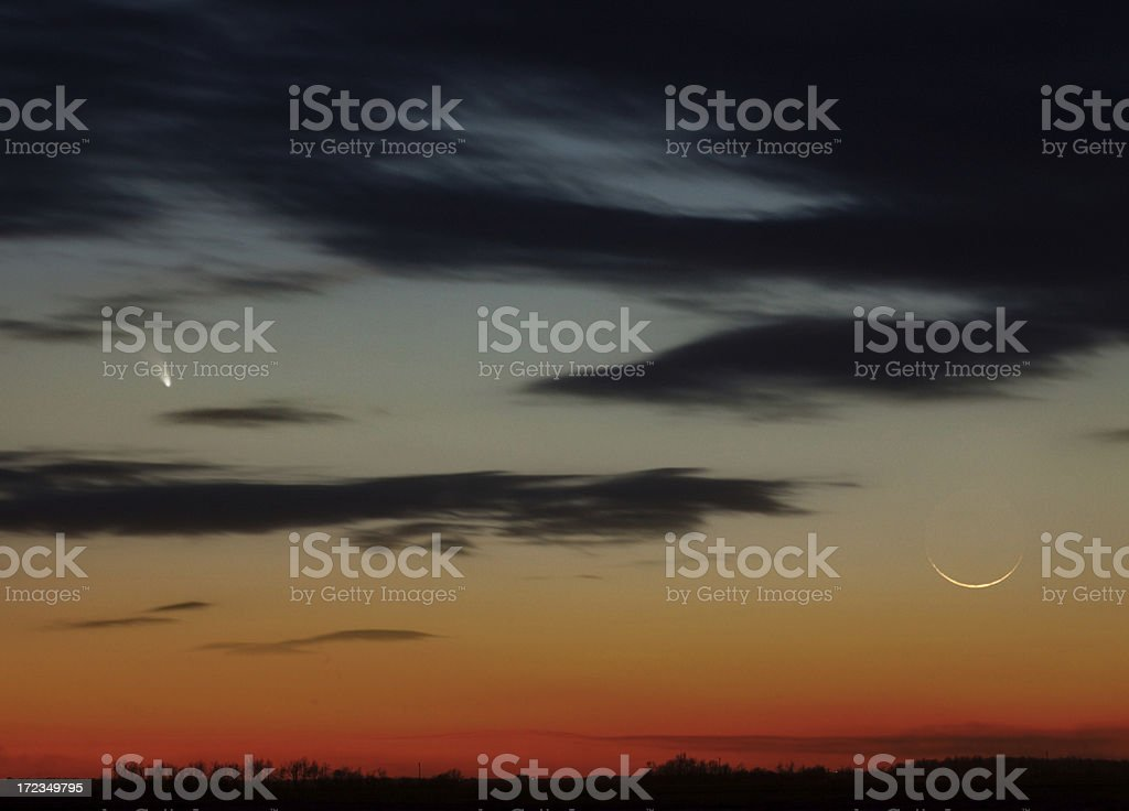 Comet PANSTARRS and Evening Crescent Moon royalty-free stock photo