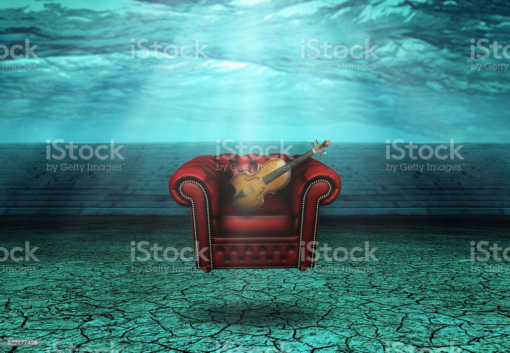 Comfort Chair with Violin Under the Waves stock photo