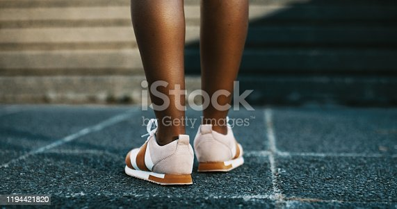 Low angle shot of a woman out for a run