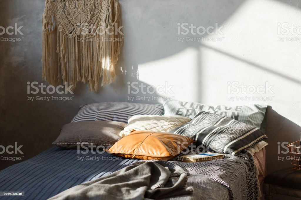 comfort loft bedroom interior with bed in gray color. Concrete wall on background stock photo