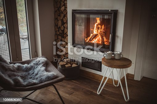 Cozy home interior, everything is ready for winder night, fireplace, hot chocolate