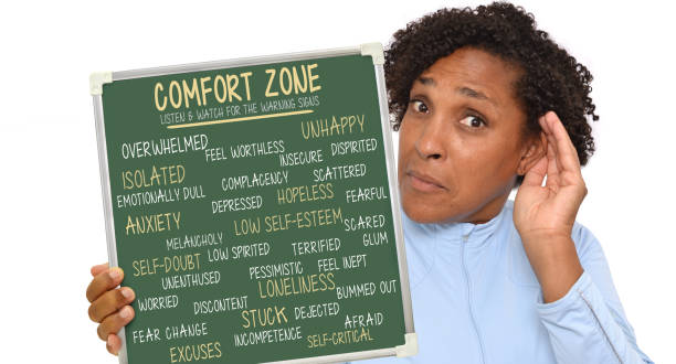 Comfort Zone Comfort Zone: Listen & Watch for Warning Signs Chalkboard (unhappy, anxiety, overwhelmed, depressed, loneliness) held by woman extending ear looking at camera listening on white background low self esteem stock pictures, royalty-free photos & images