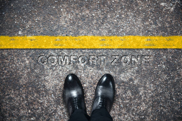 comfort zone text  with man shoes man shoes with comfort zone text on asphalt time zone stock pictures, royalty-free photos & images