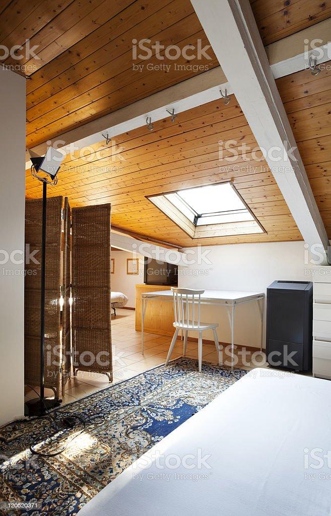 comfortable bedroom in loft royalty-free stock photo