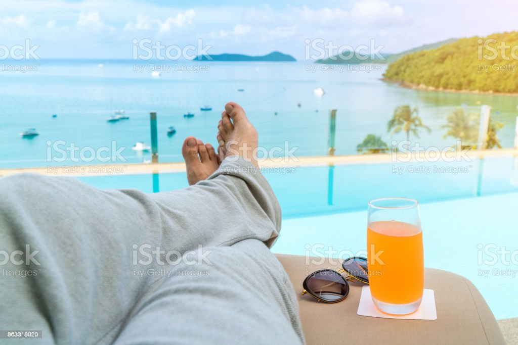 comfortable chair and orange juice drink, copy space. stock photo