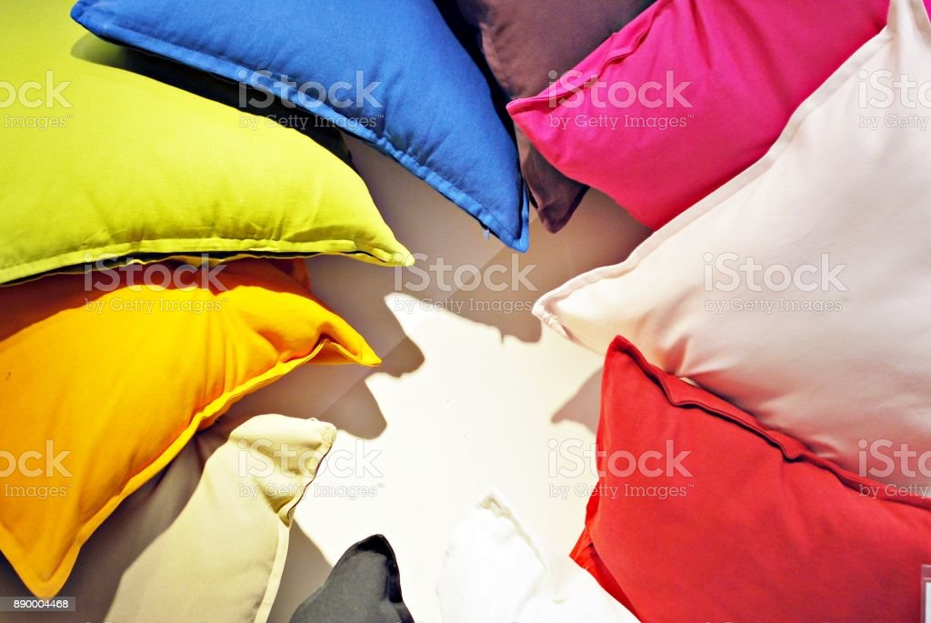 comfortable colorful fabric cushions on modern store shelves stock photo
