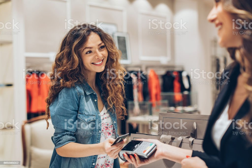 Comfortable contactless payment in the fashion store stock photo