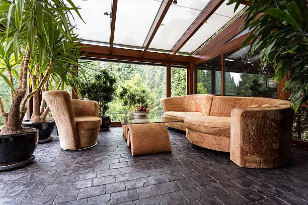 comfortable lounge set in conservatory - оранжерея стоковые фото и изображения