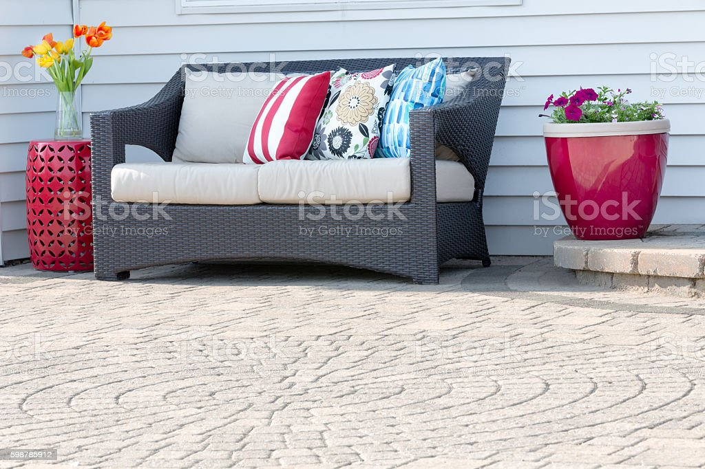 Comfortable modern settee on an outdoor patio stock photo