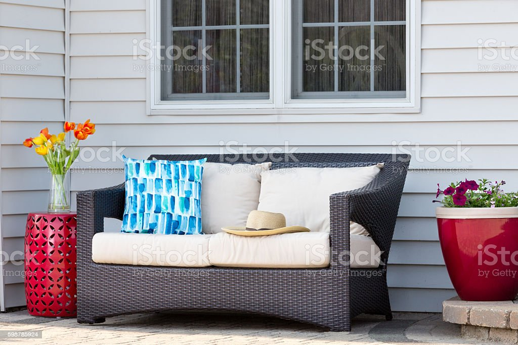 Comfortable outdoor living area on a brick patio stock photo