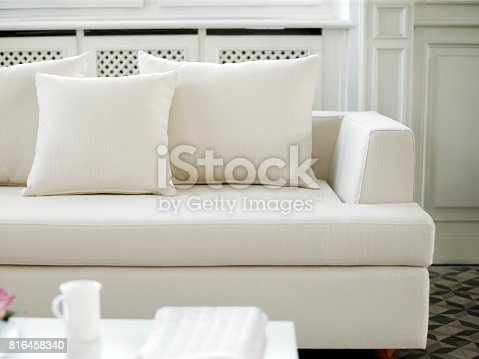 cat on sofa in a room