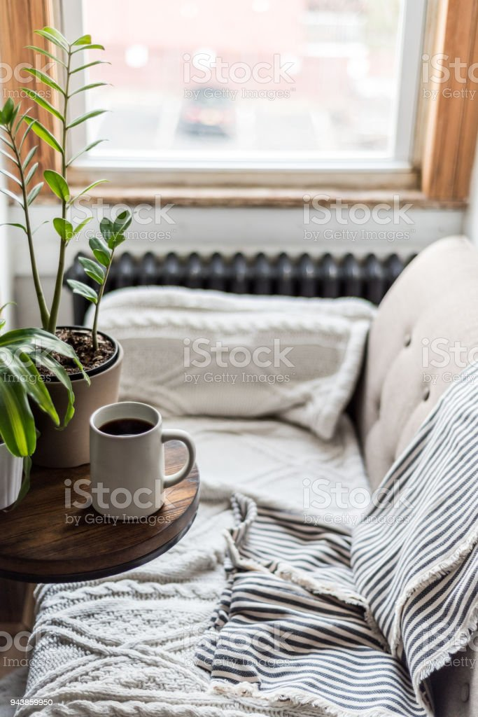 A comfortable sofa with coffee in a cozy home stock photo