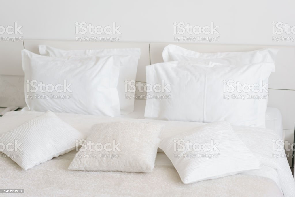 Comfortable Soft Pillows On The Bed. Close Up White Bedding Sheets And  Pillow On